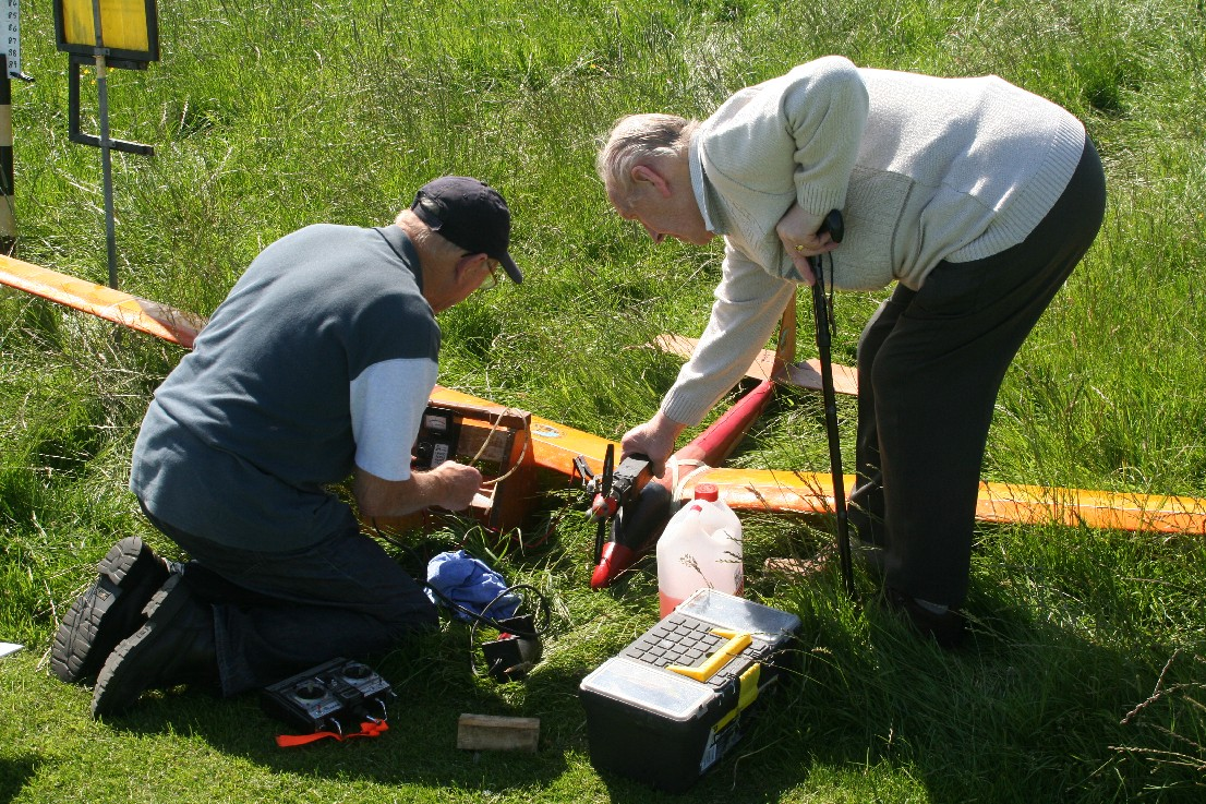 John Prepairing Glider With Help From Louis